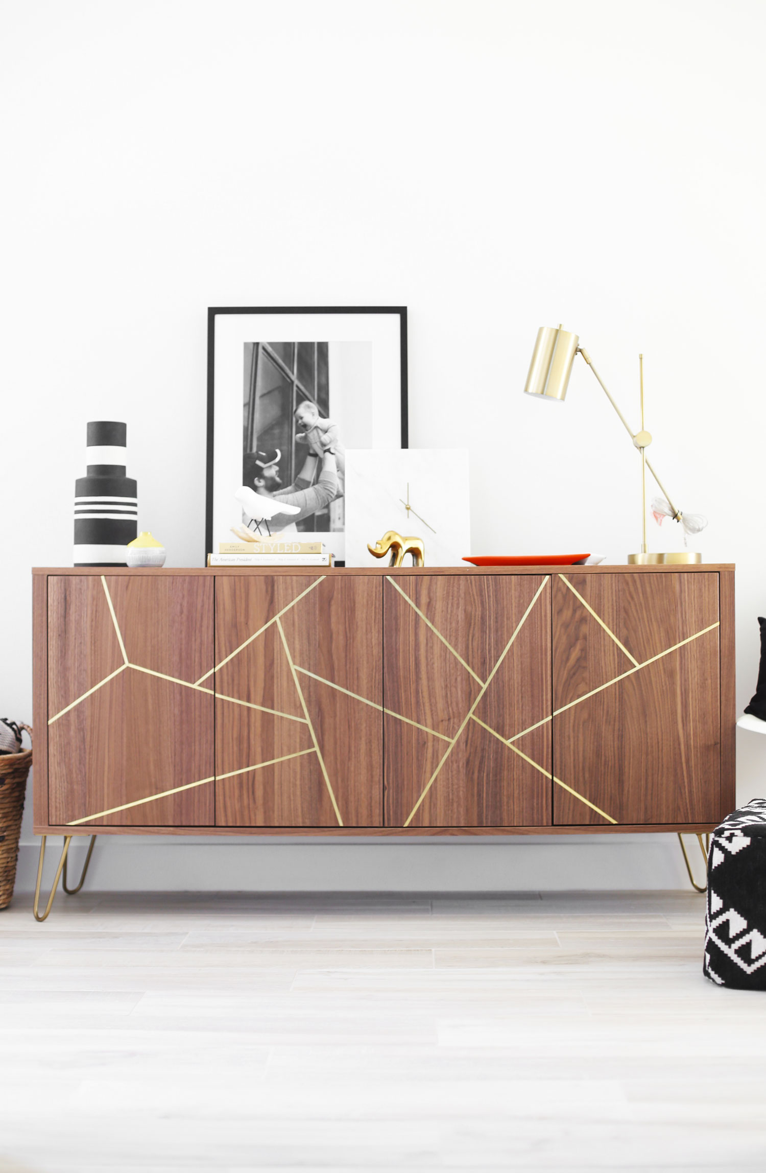 It took only some tape and paint to make this IKEA cabinet into a mid century modern design dream