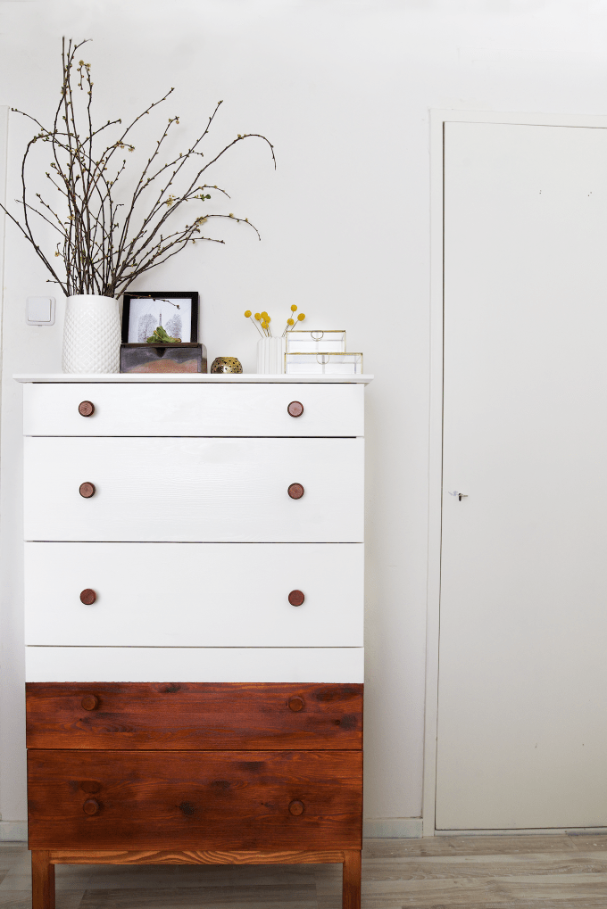 This IKEA dresser is half modern magic with a little bit of paint and a little bit of wood stain, plus some gorgeous hardware