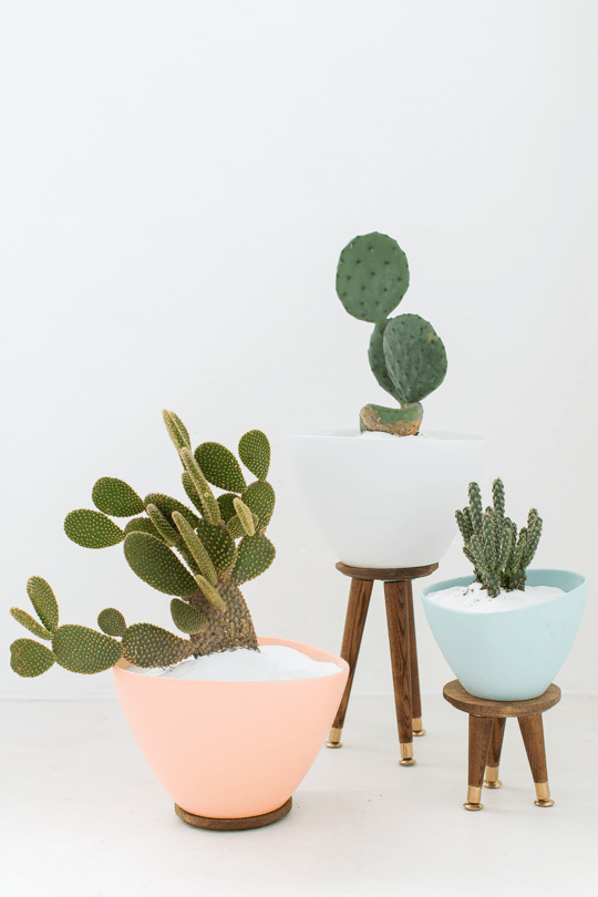A simple Bigarra Ikea Planter can be transformed into adorable modern decor pieces with some paint and succulents