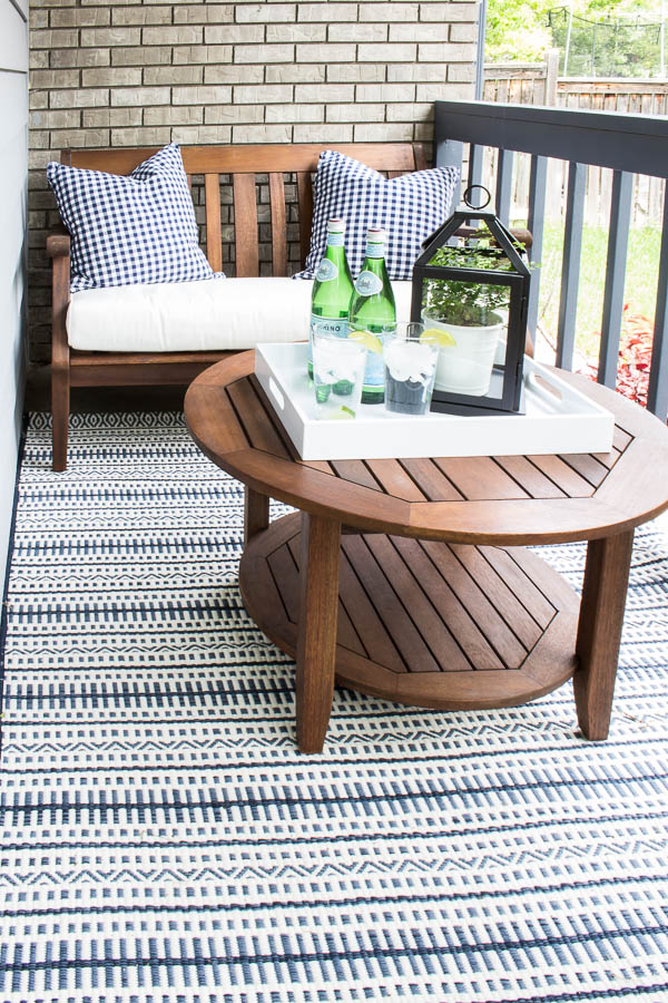 Even a small front patio like this one can be maximized with a cute wooden bench and table