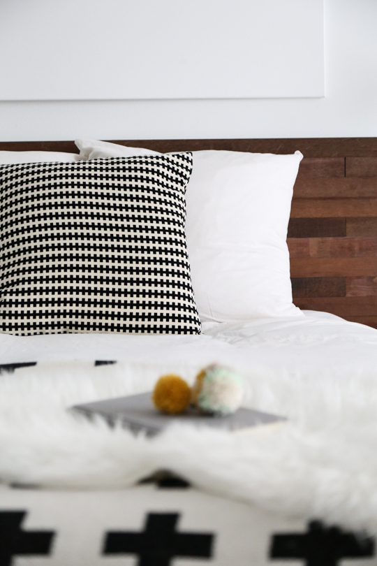 This modern wooden headboard is a super simple DIY project to add a contemporary touch to your bedroom