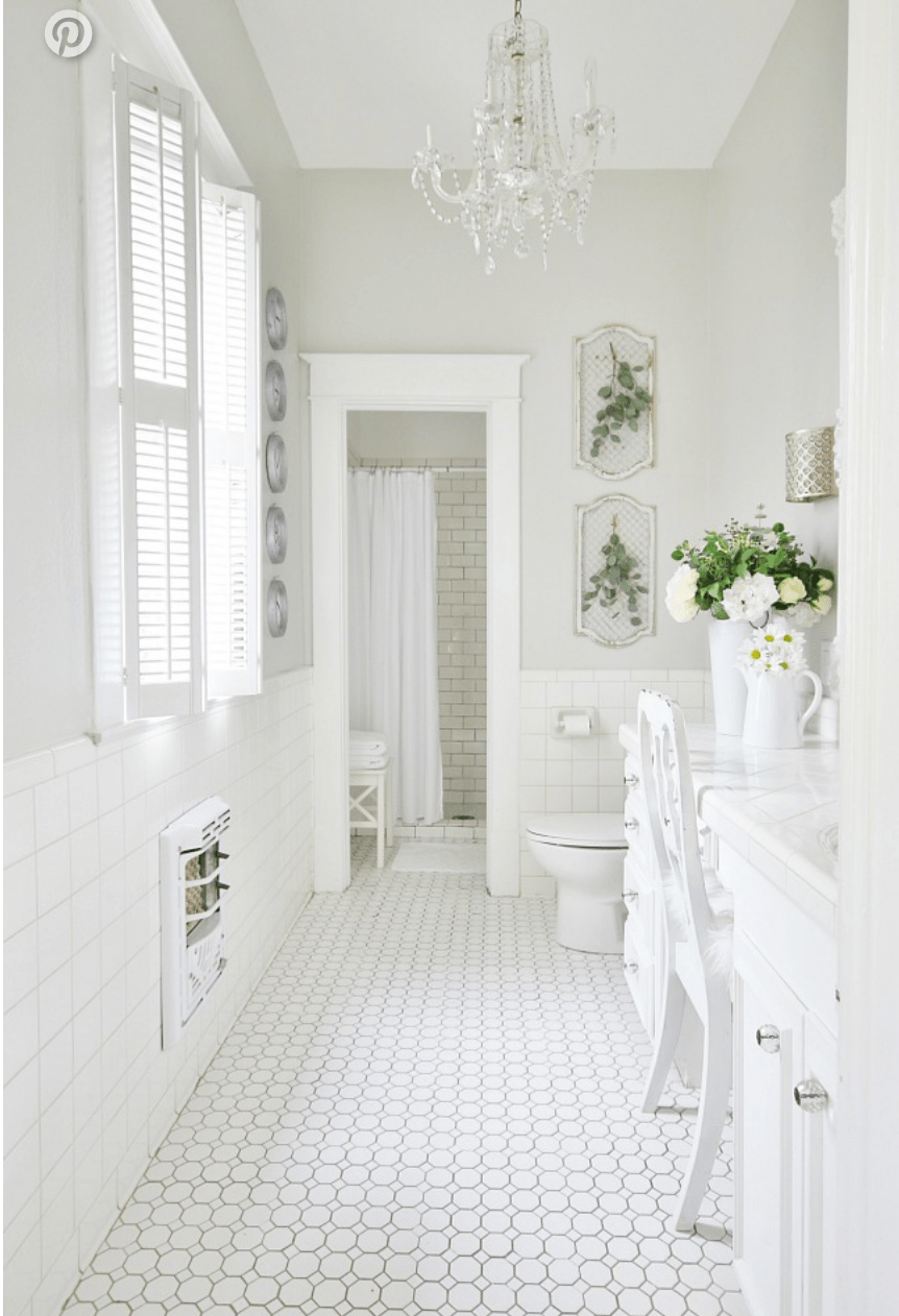 This simple bathroom space done in all white is clean and simplistic.