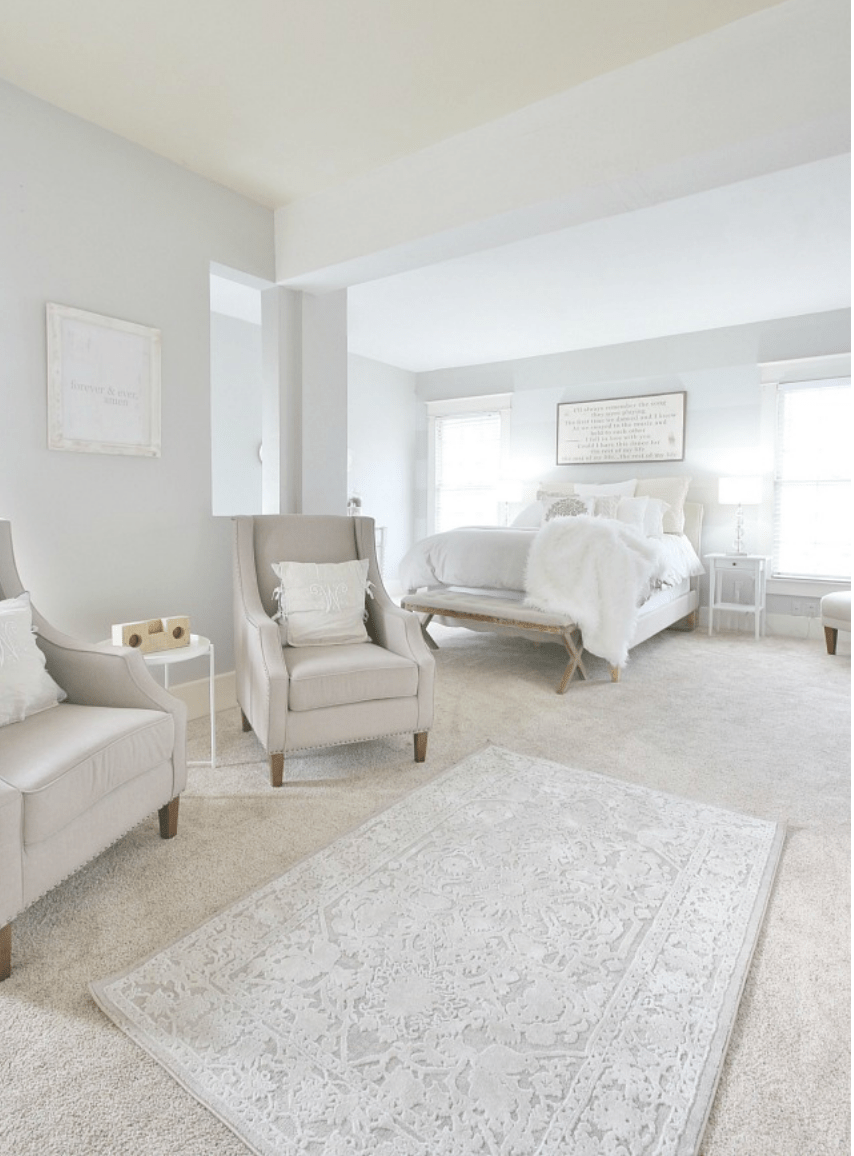 The gray tufted chairs compliment the gray tones in the rug and walls.