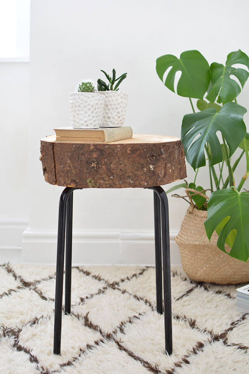 This IKEA side table got a major upgrade when this DIYer removed the simple wooden table surface and replaced it with a tree chunk log - perfect country chic style!