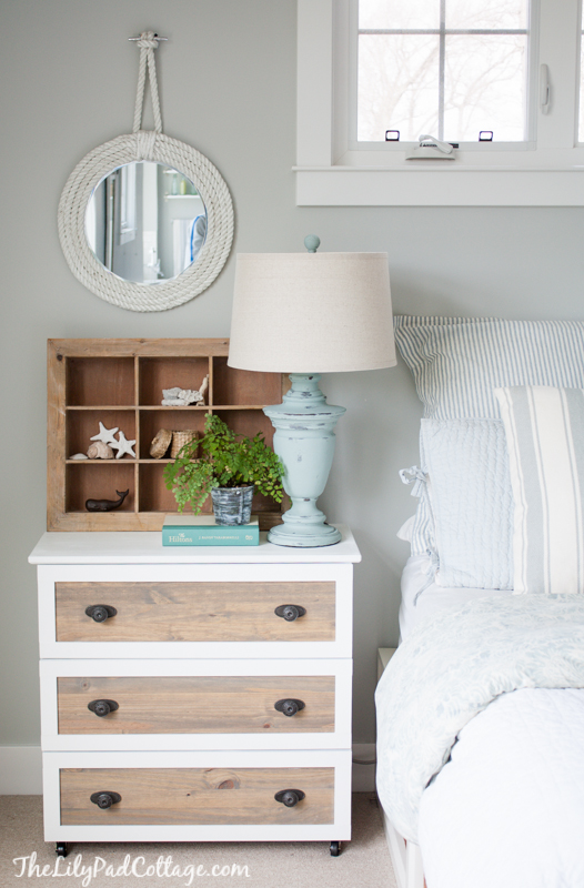 This IKEA side table got a fresh coat of paint, but it's the light stain on the drawers that really gives it that farmhouse look