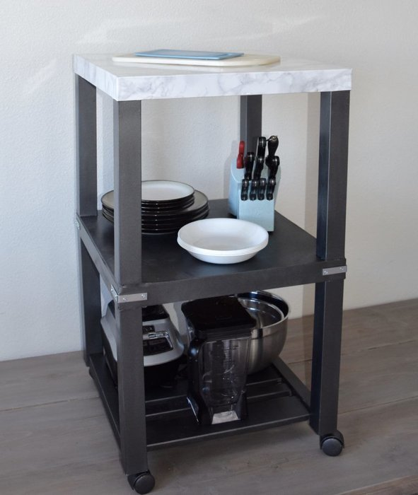 This industrial kitchen cart with a marble top is modern.