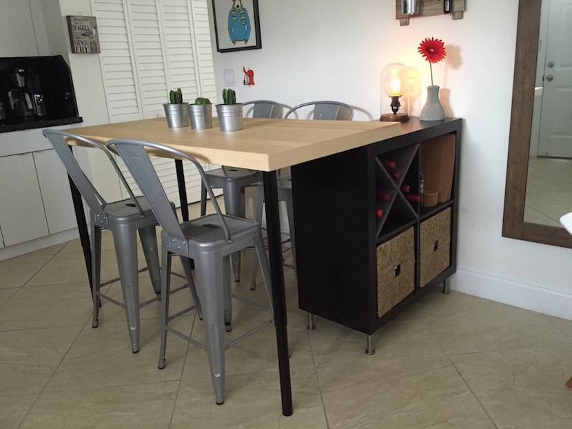 These gray chairs compliment the light wood kitchen table.