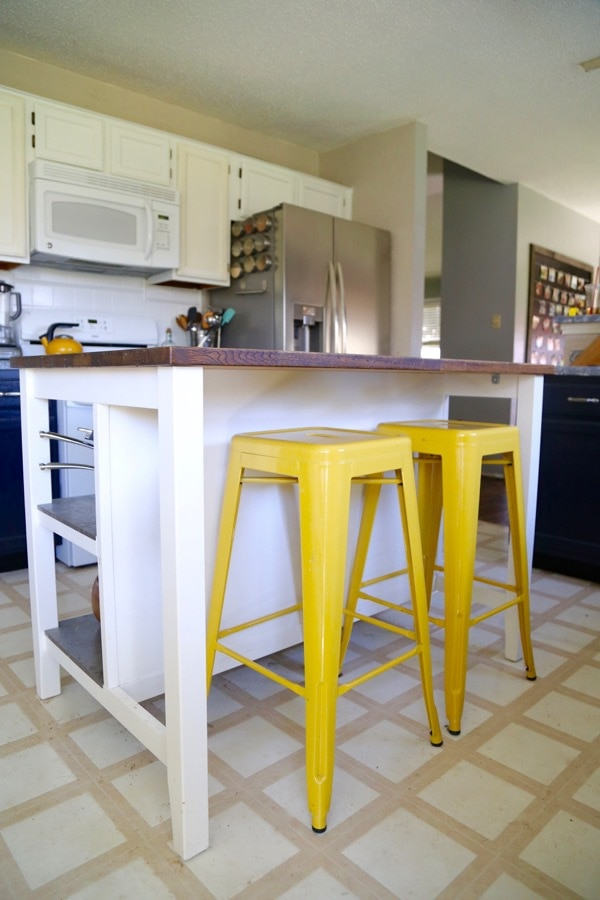 These yellow bar stools add a pop of color to this kitchen.