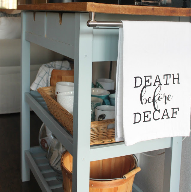 This blue color of this coffee bar compliments the farmhouse wood top.