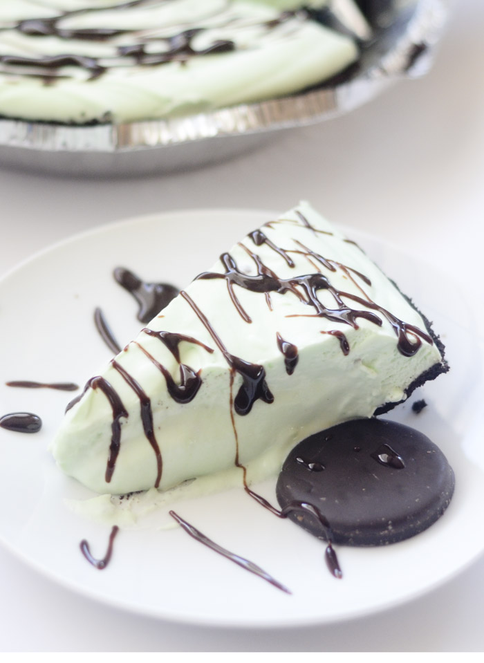 This frozen grasshopper pie topped with chocolate and a cookie is divine.