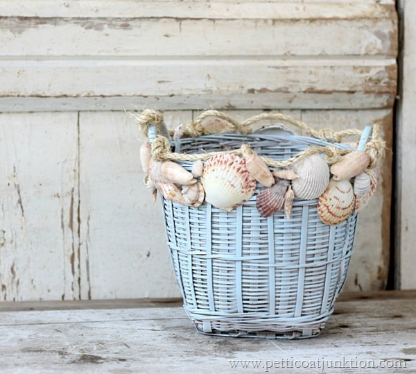 This DIY painted basket with seashells is coastal and beachy.
