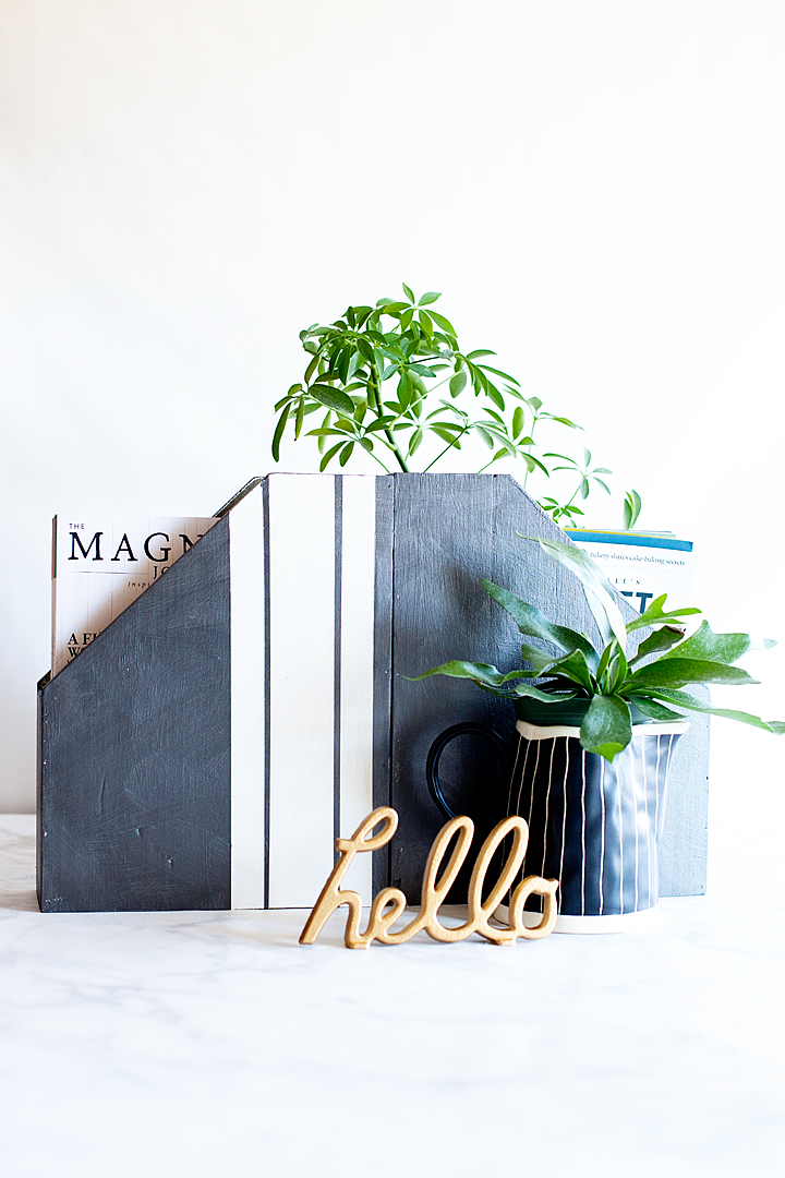 This simple piece of wood was updated with some new paint and now is a gorgeous magazine holder