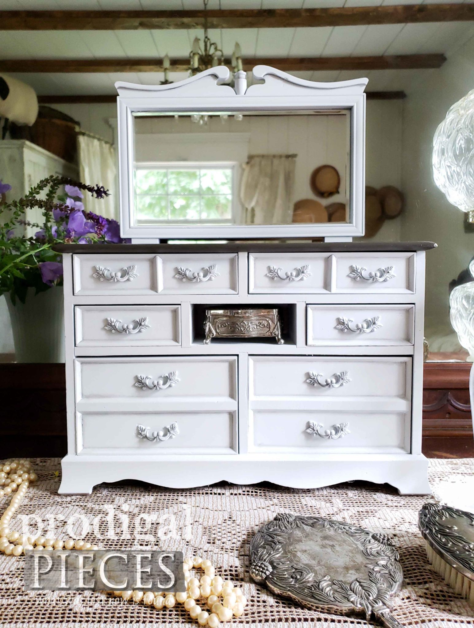 This mini vintage dresser is a darling decor element for the vanity.