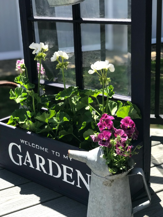 Love this garden shelf window customized with some lettering and flowers