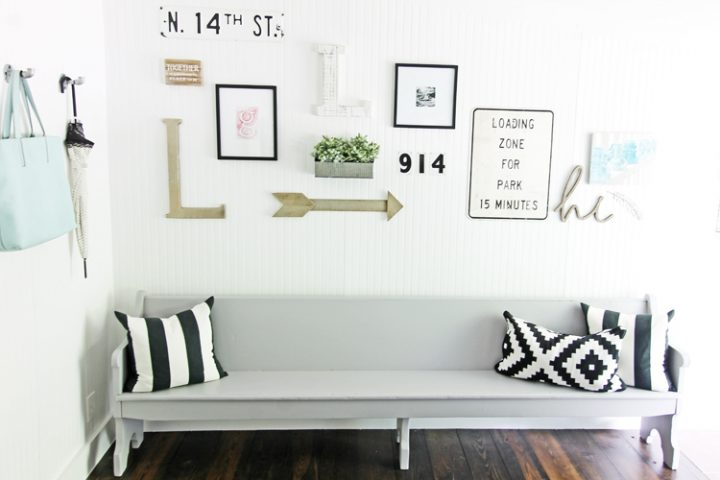 This contemporary hallway bench looks amazing under this gallery wall of thrift store finds