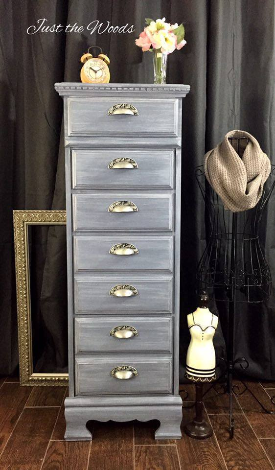 This renovated dresser painted blue with antique handles is beautiful.