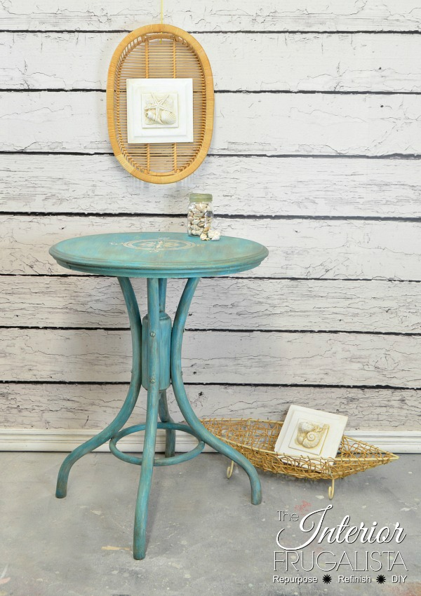 Repainted pedestal table that's perfect for a patio or deck