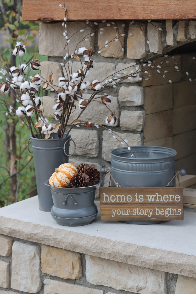 thrift store tins repurposed into farmhouse style front porch planters