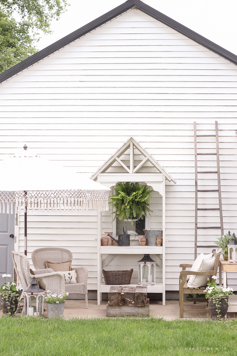 this lovely farmhouse style outside sitting area is the perfect place to soak up some sun and company