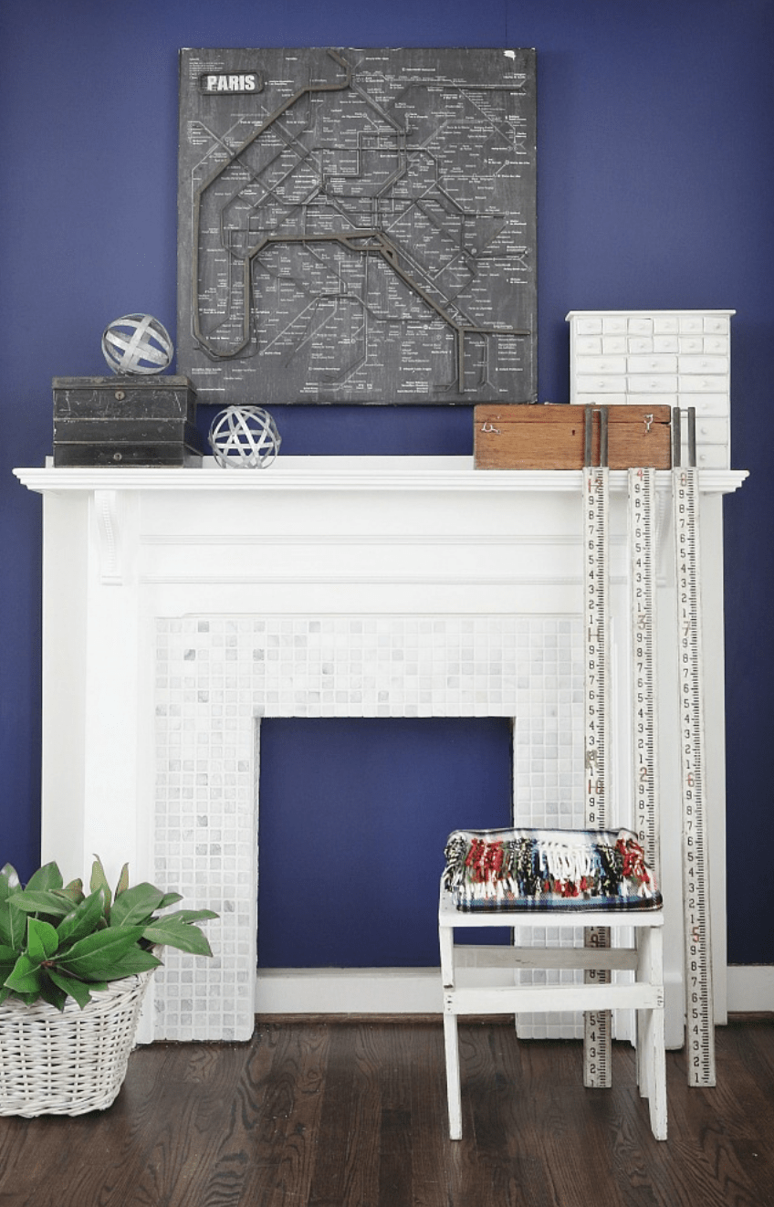 this mantle piece decoration is city-inspired with a hint of a farmhouse touch