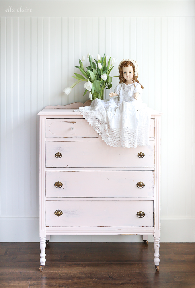 This vintage blush dresser pops against the dark stained wood floors.