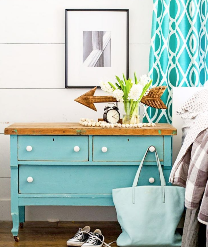 This blue bedside dresser with white handles is coastal and bright.
