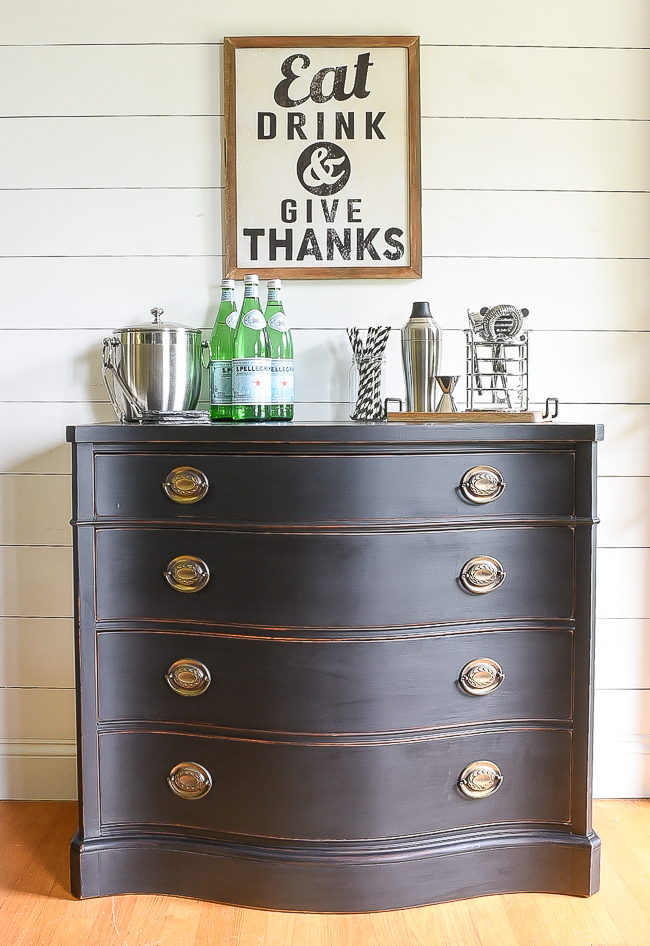 This refinished dark stained dresser makes the most adorable bar area.