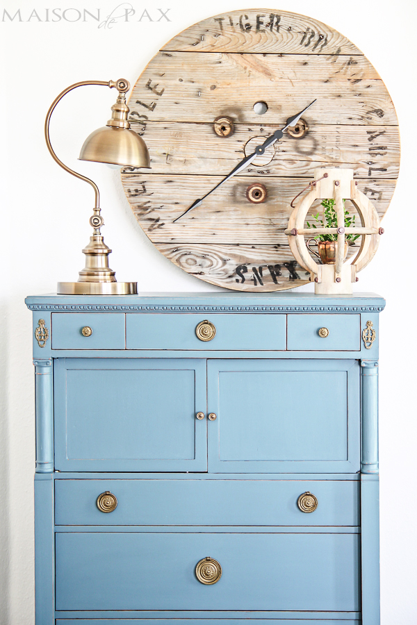This light blue dresser is unique and looks great with the large wooden clock.