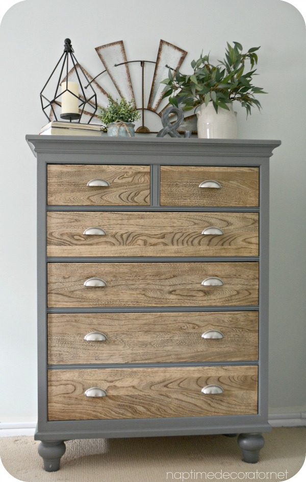 This gray dresser with silver handles and wood drawers is a one of a kind farmhouse piece.