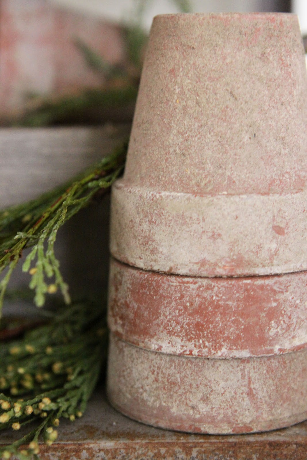 These rustic flower pots look vintage.