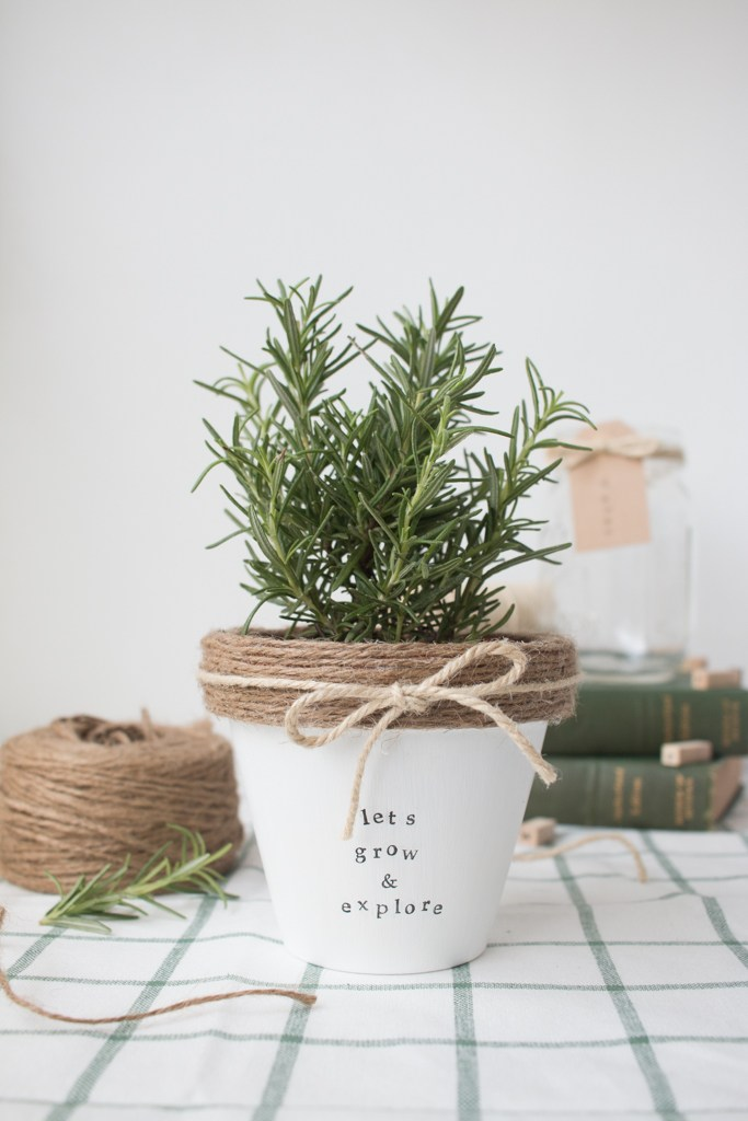 This adorable white flower pot with burlap string is perfect for herbs.