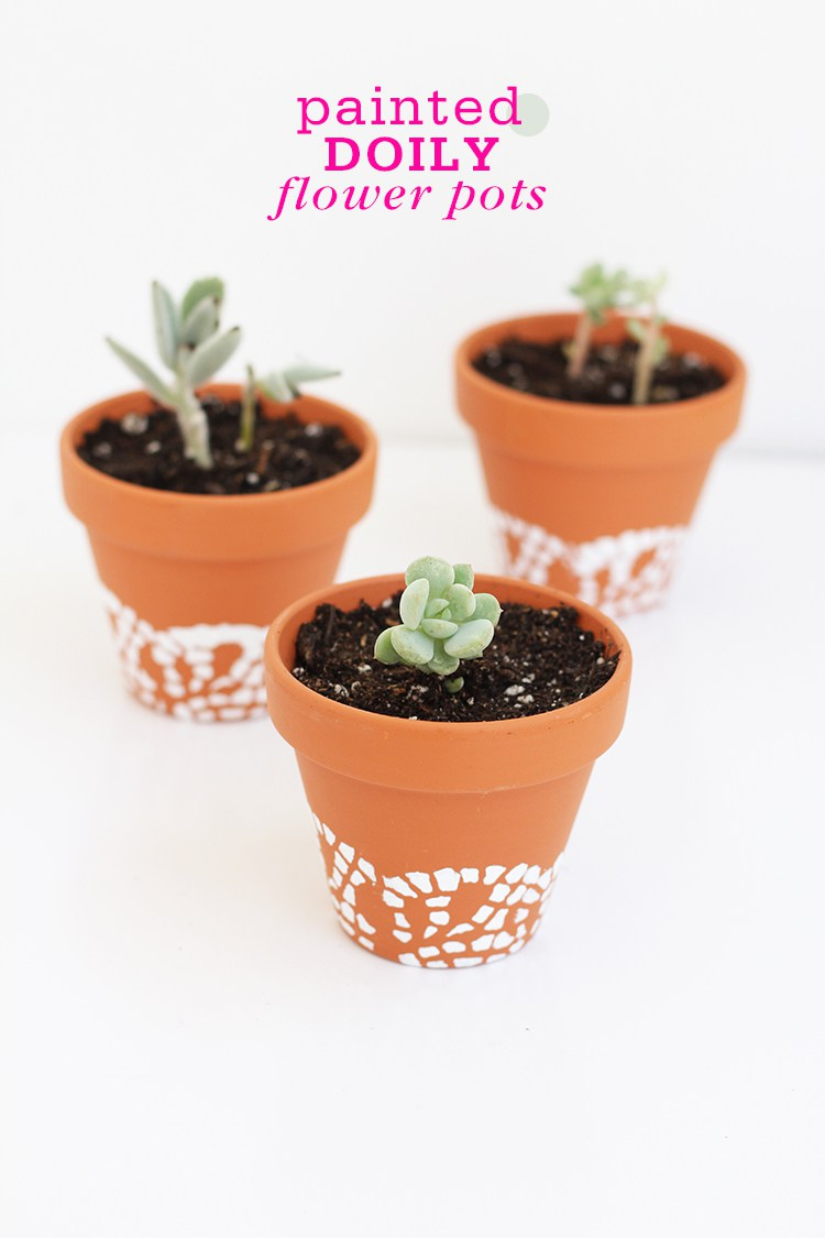 These DIY doily painted flower pots are unique and fun.