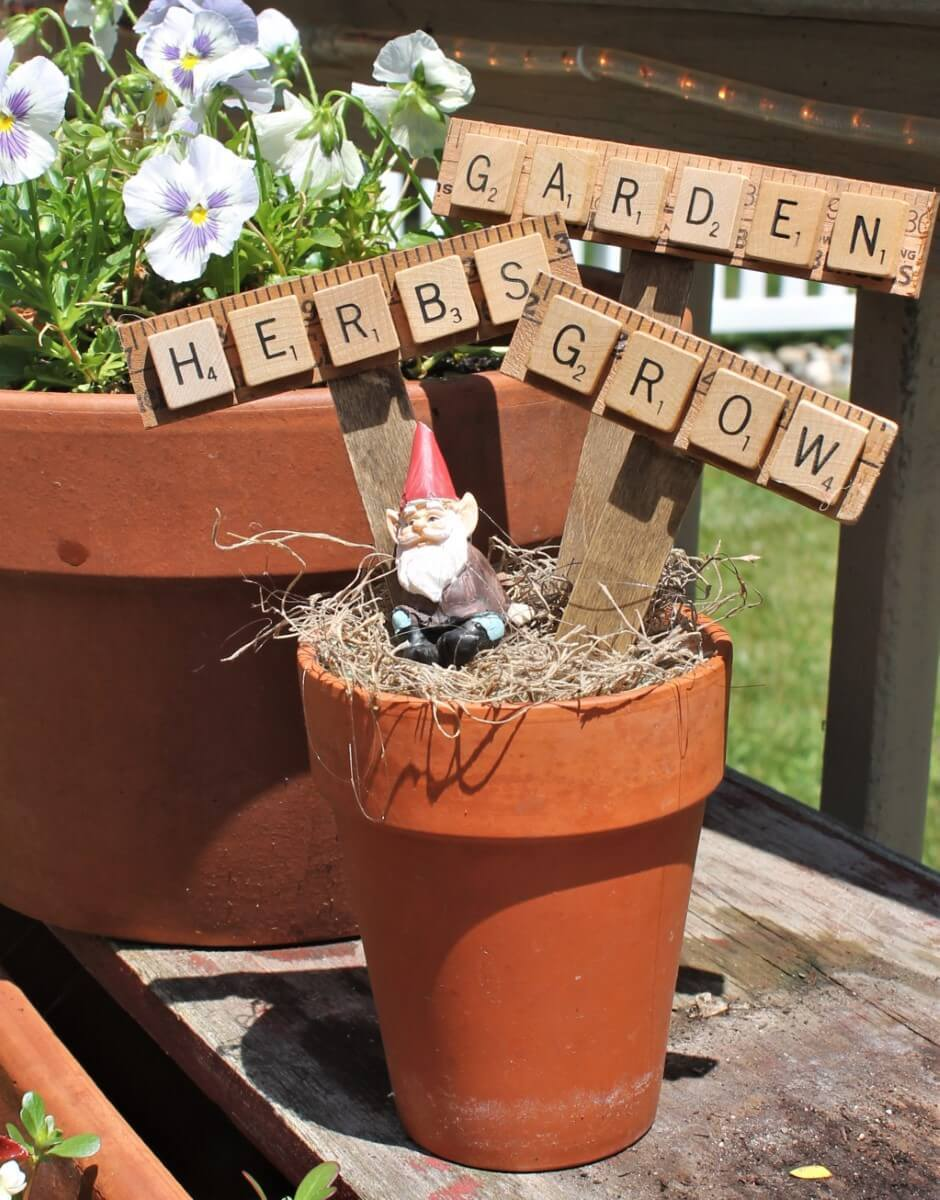 yard sticks and scrabble letters make these super cute planter sticks
