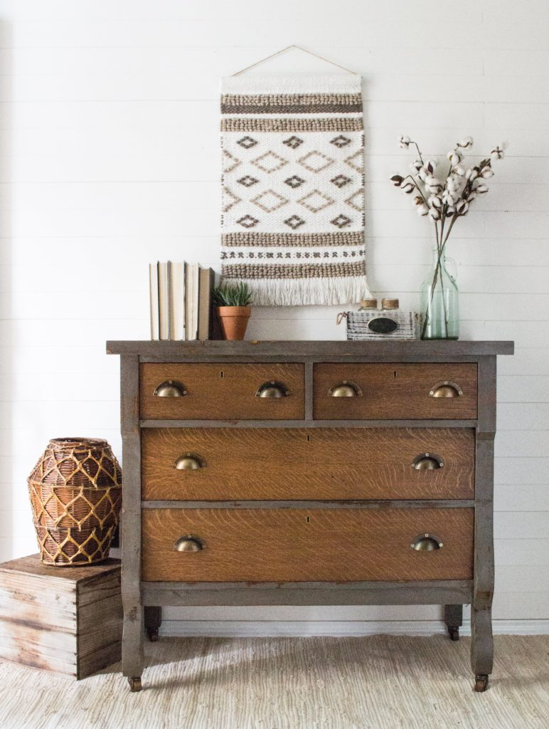 Thrift store dressers are ideal candidates for industrial style makeovers like this dark wooden dresser