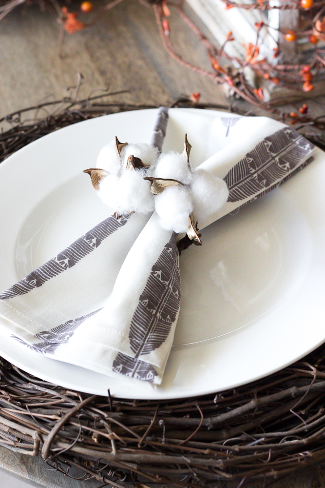 These cotton candle holders pair well with the table's Autumn theme.