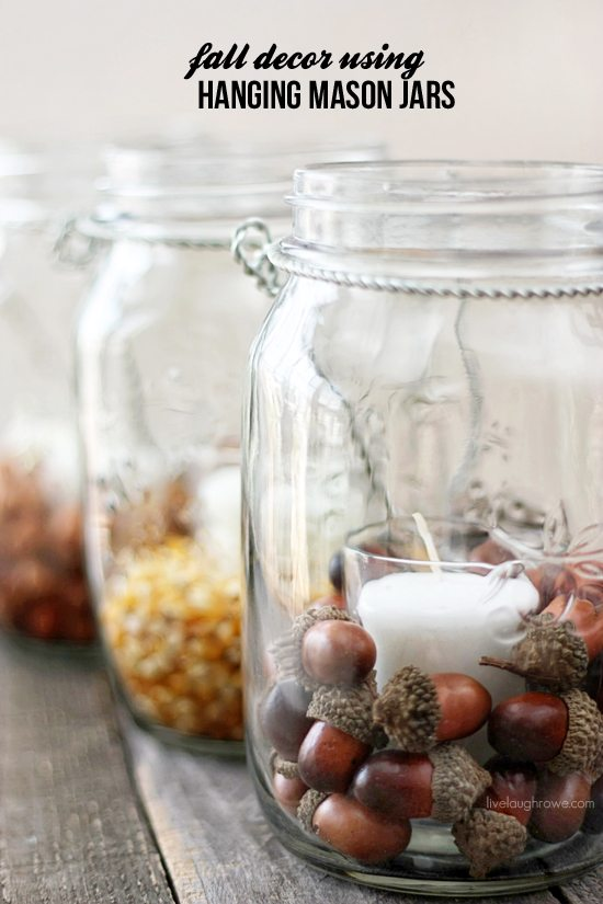 These hanging mason jars filled with acorns are perfect for fall.