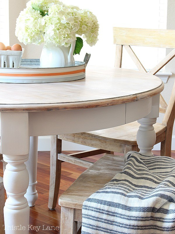 This farmhouse DIY is a perfect kitchen table that blends right in with the farmhouse decor in this kitchen