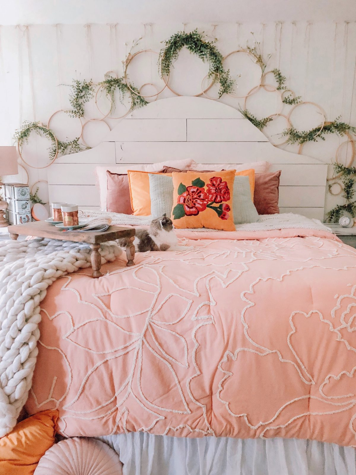 this bedroom is full of farmhouse style diys from the pallet headboard to the gorgeous hoop decor and wall detail