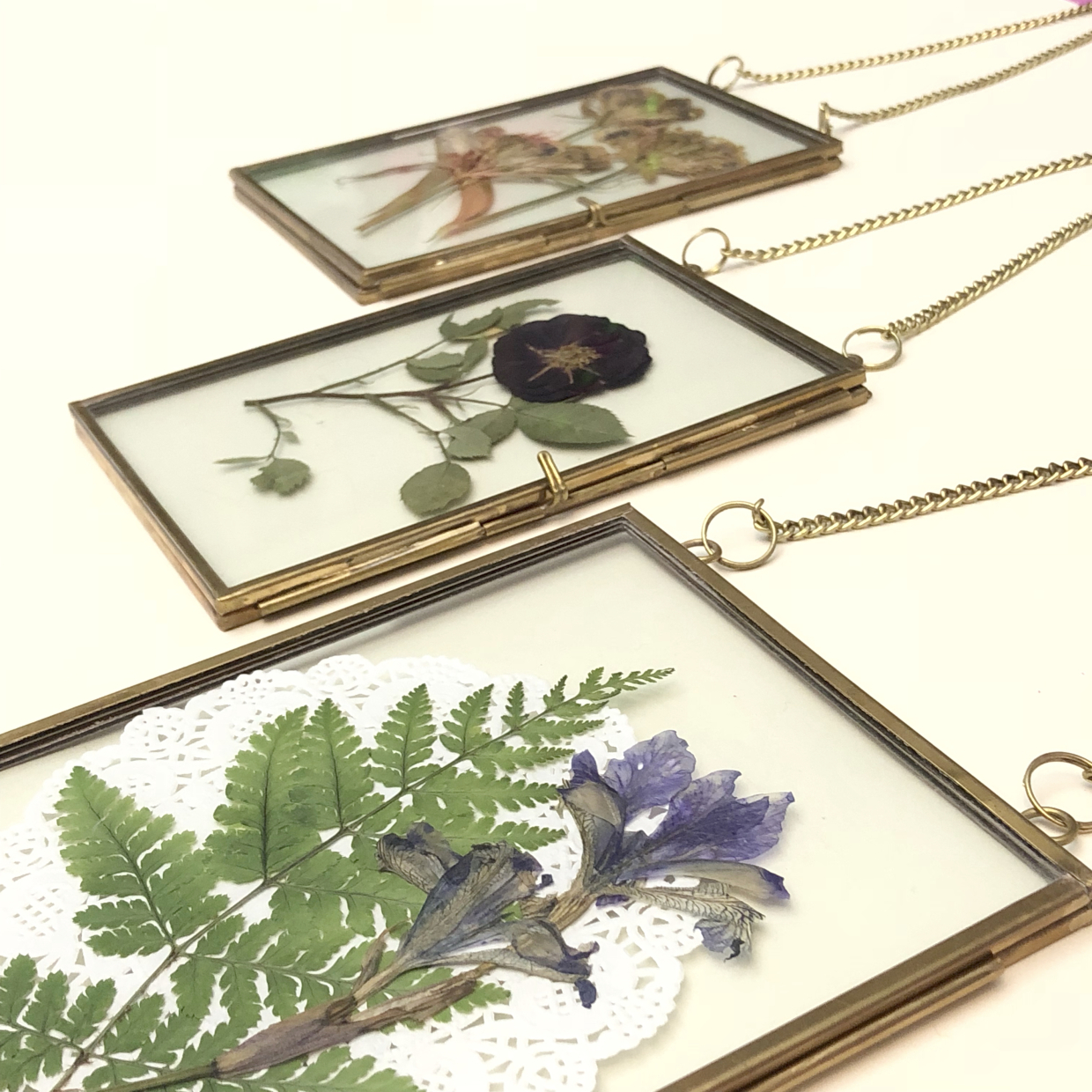 These stunning pressed flower pendants are unique pieces to hang in your home - and a fun DIY