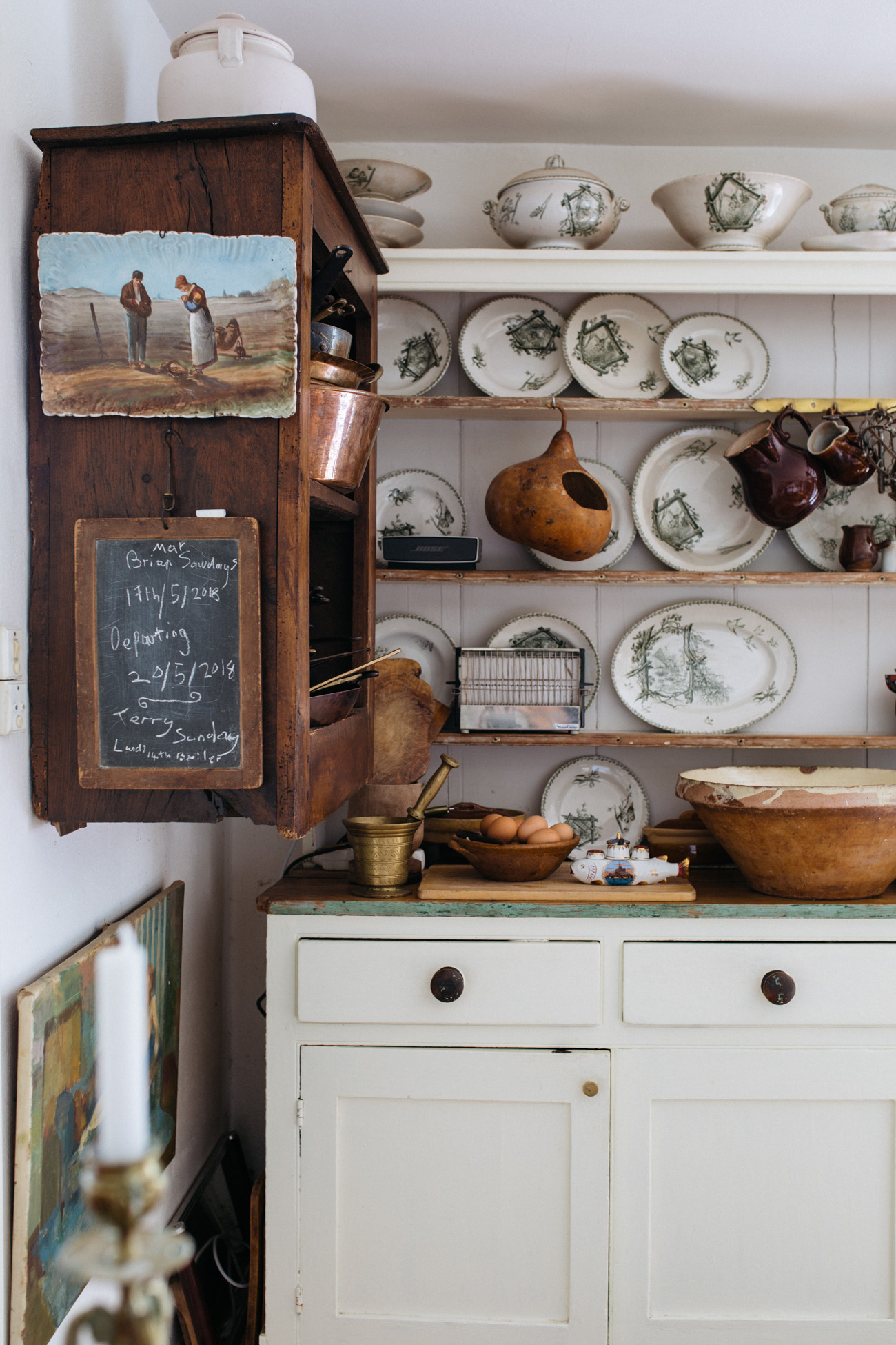 This gorgeous farmhouse kitchen is full of DIY elements and vintage pieces that bring the whole style together