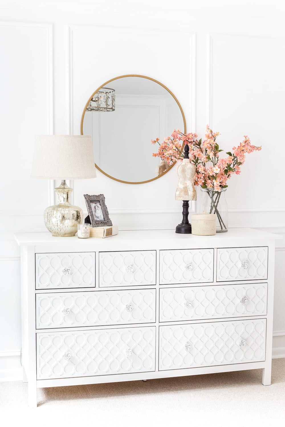 This dresser is a gorgeous farmhouse diy that gives this simple white room an extra touch of elegant style