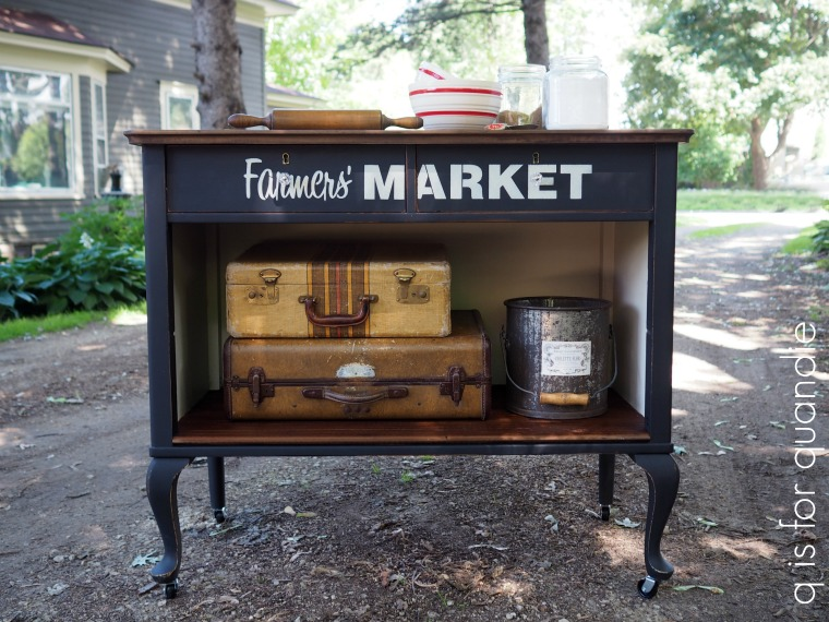 This side table makeover is a gorgeous farmhouse style piece with vintage elements like the thrifted suitcases