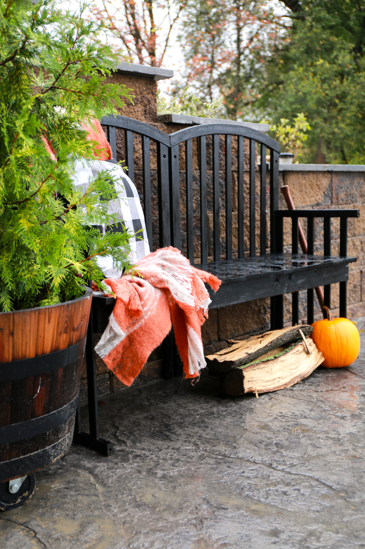 This old crib turned outside bench is creative and looks great on the patio.