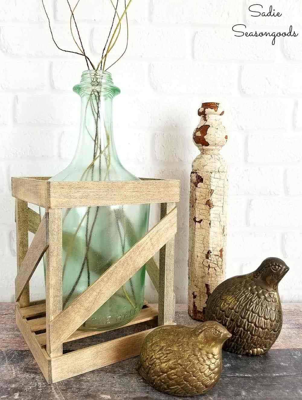 This thrift store jug with wood accents is farmhouse chic.