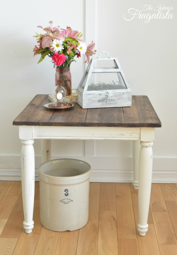 This adorable refurbished thrift store table with a wooden table top is rustic and cute.