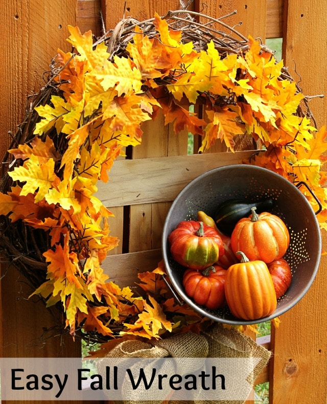This easy DIY wreath screams fall with fresh leaves, sticks, and pumpkins.