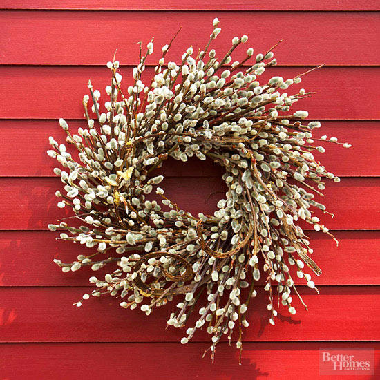This simple DIY fall wreath looks great against the red exterior.
