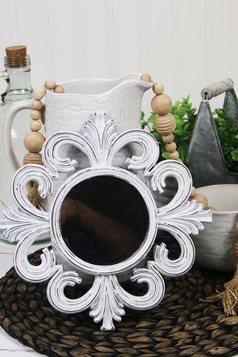 This Quick and Easy DIY Dollar Store Farmhouse Mirror Hack has a fabulous high end look and it could not be more simple and it will probably take 15 minutes total!