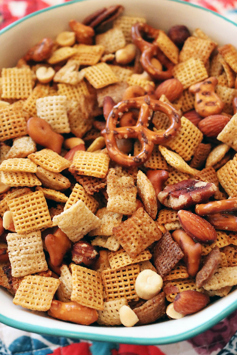 Quick and Easy Vegan Slow Cooker Chex Mix is just what your party needs!  Why not have a snack even your Vegan Friends can enjoy.  Same great taste!