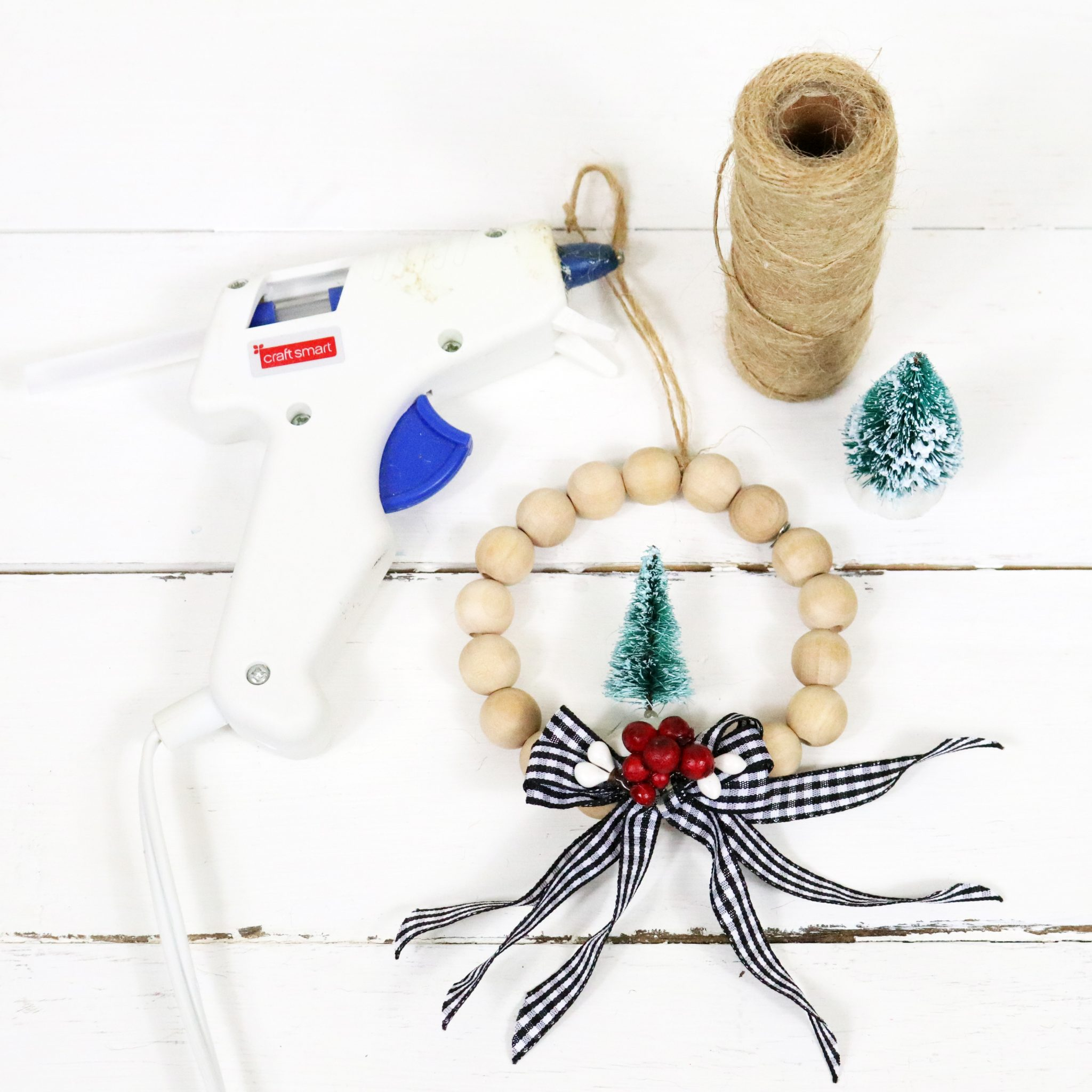 It's time for another Quick and Easy DIY Craft, today we are featuring DIY Farmhouse Wood Bead Wreath Ornaments that will look wonderful on your tree and perfect on your packages!